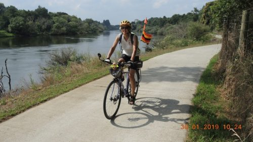 Celia Hope riding a bicycle